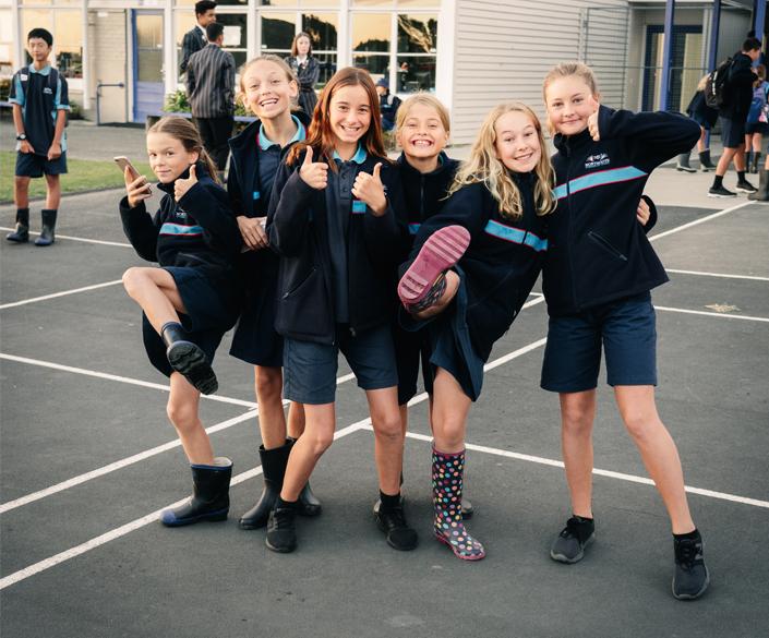 Group of schoolgirls with gumboots