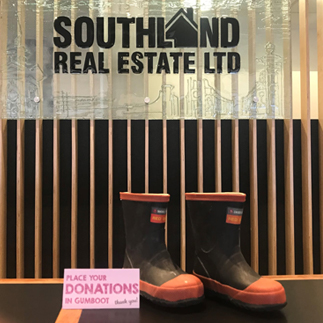 Gumboots with a donation card