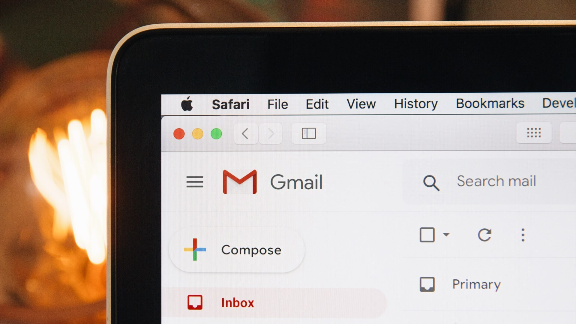 Corner of a marketer's computer open with gmail open ready to start their brand loyalty strategy.