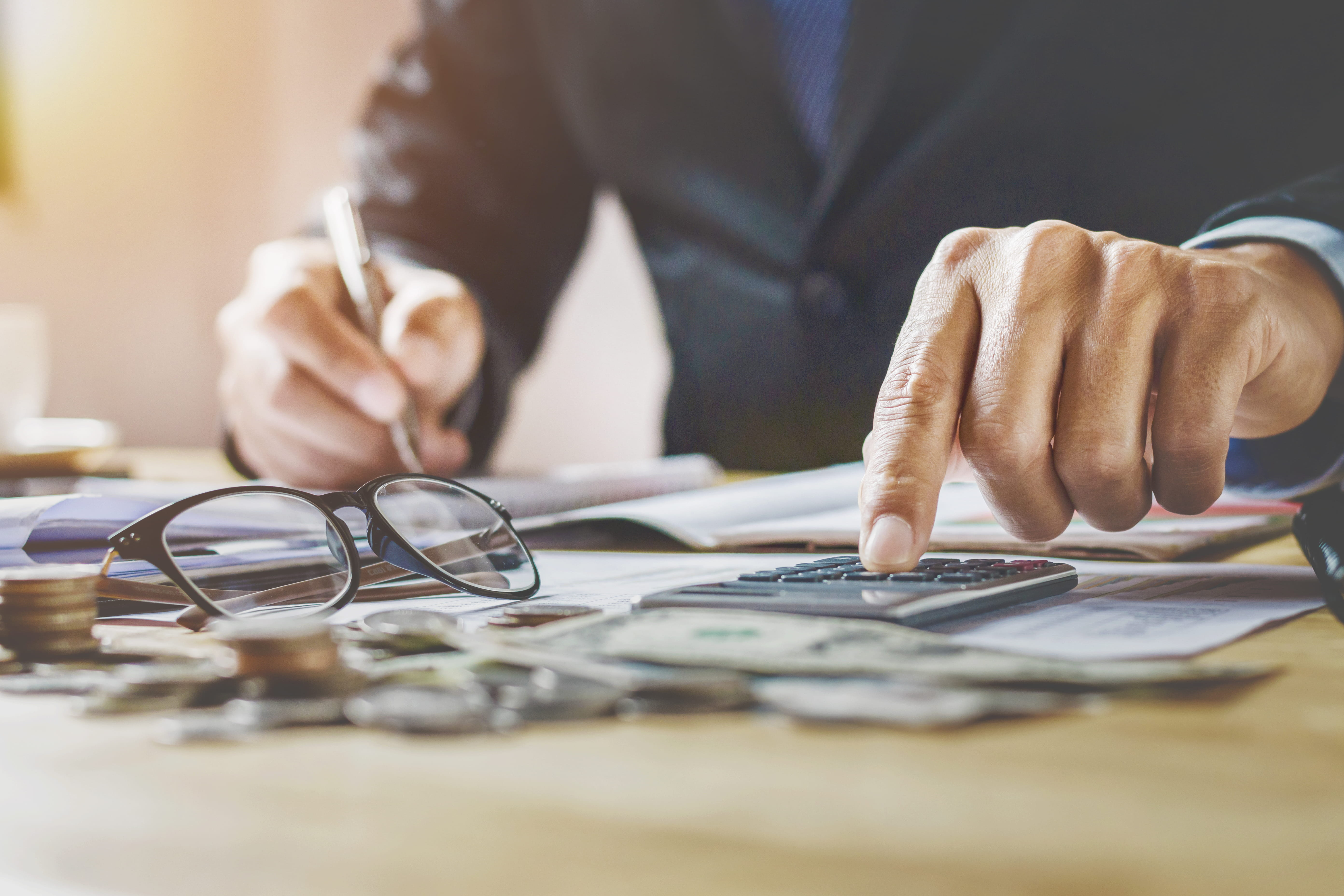 accountant working in office using calculator
