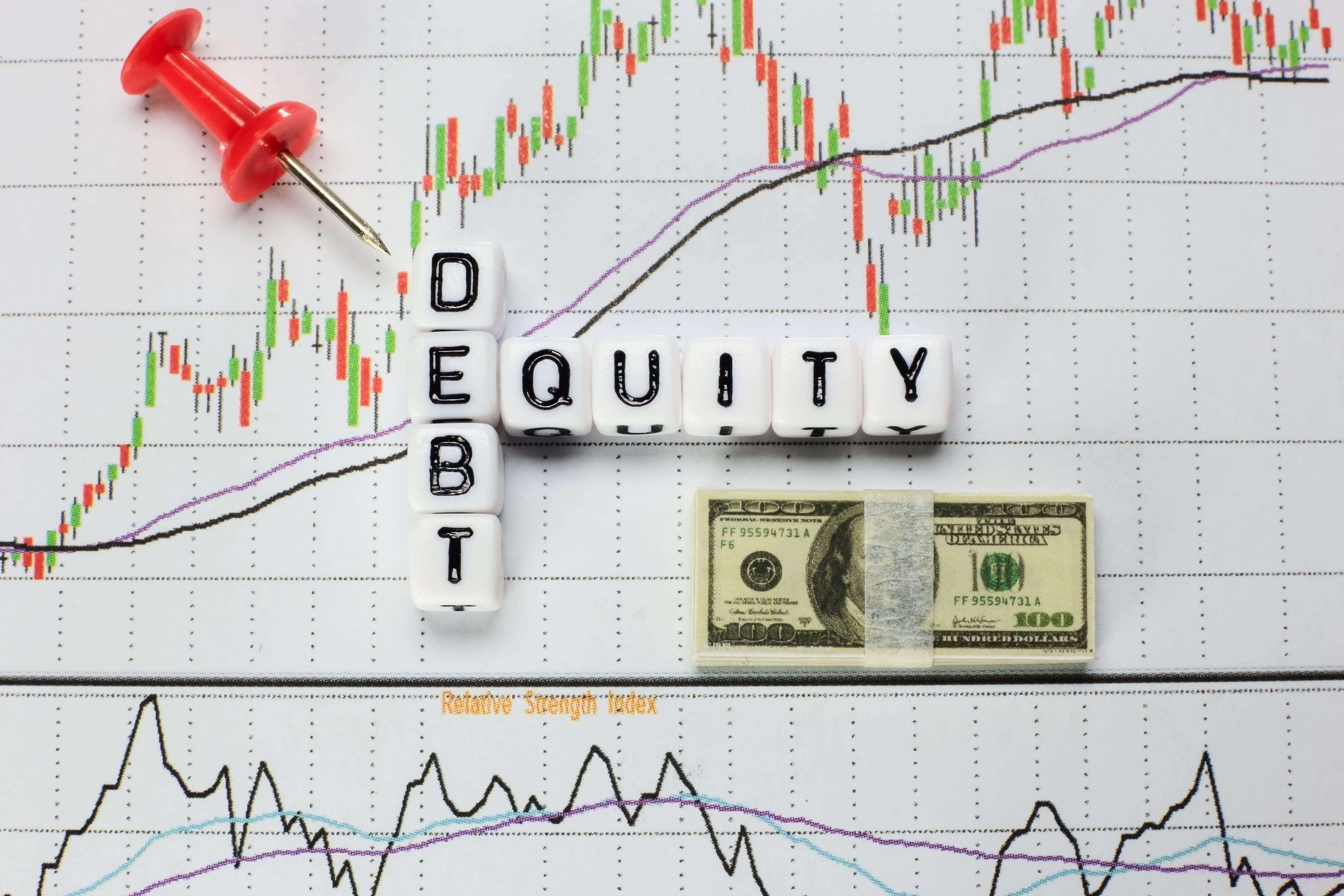 debt equity written on intersecting dice with chart in background