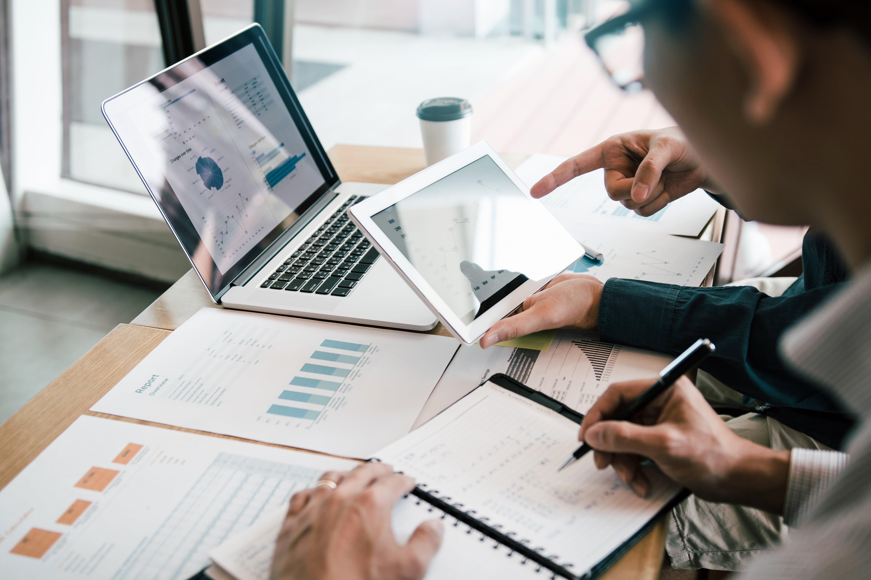 People analyzing financial statistics. Financial advisors.