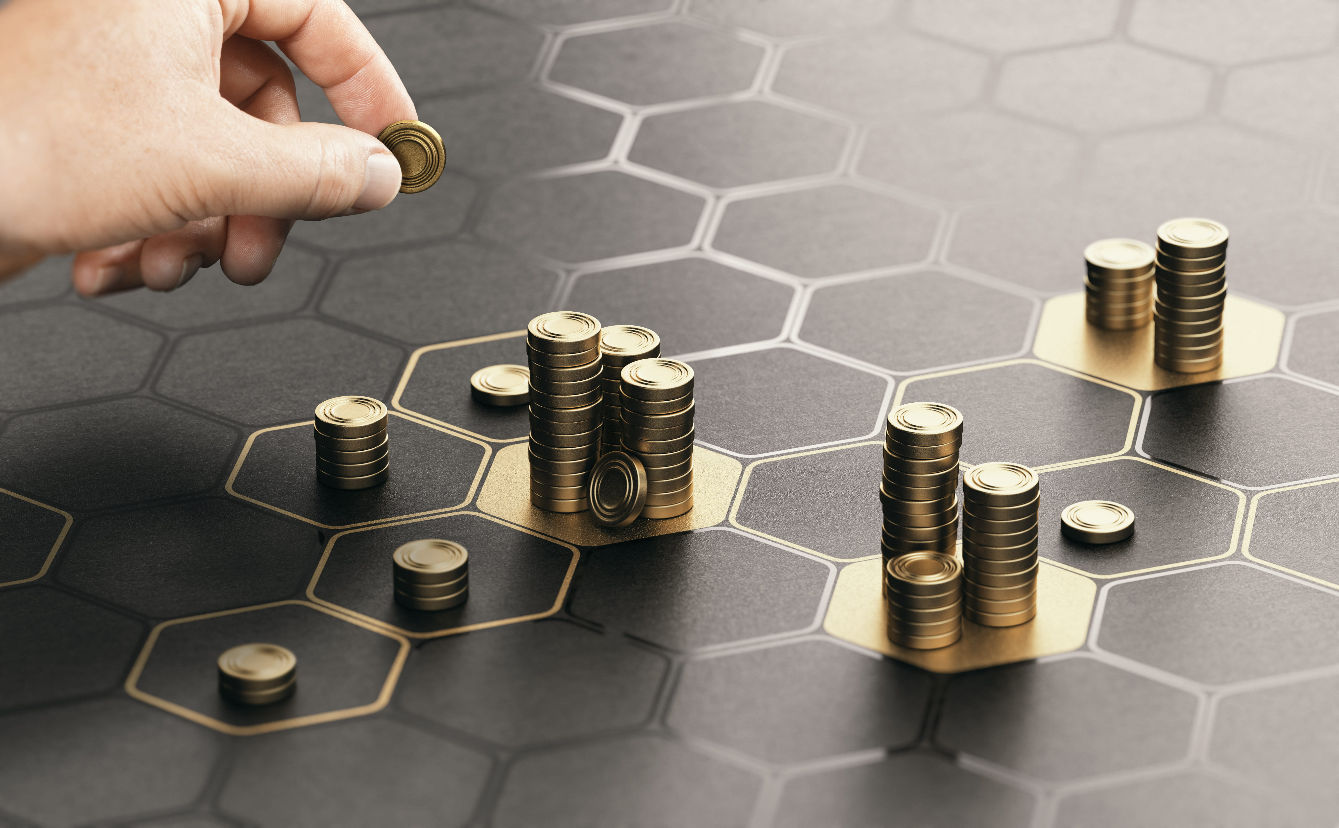 person stacking gold coins on black background with hexagonal shapes