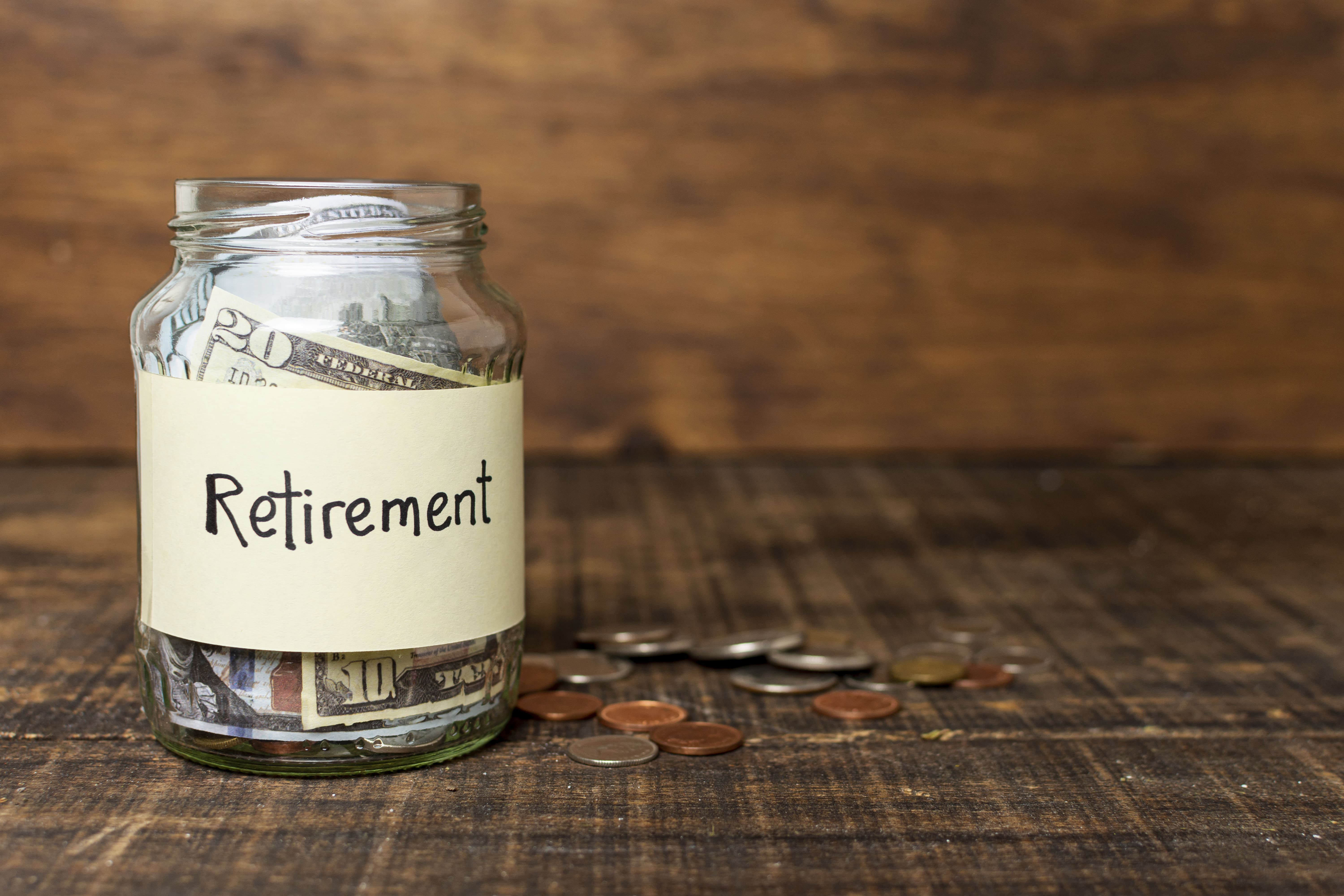 Retirement funds on a glass jar