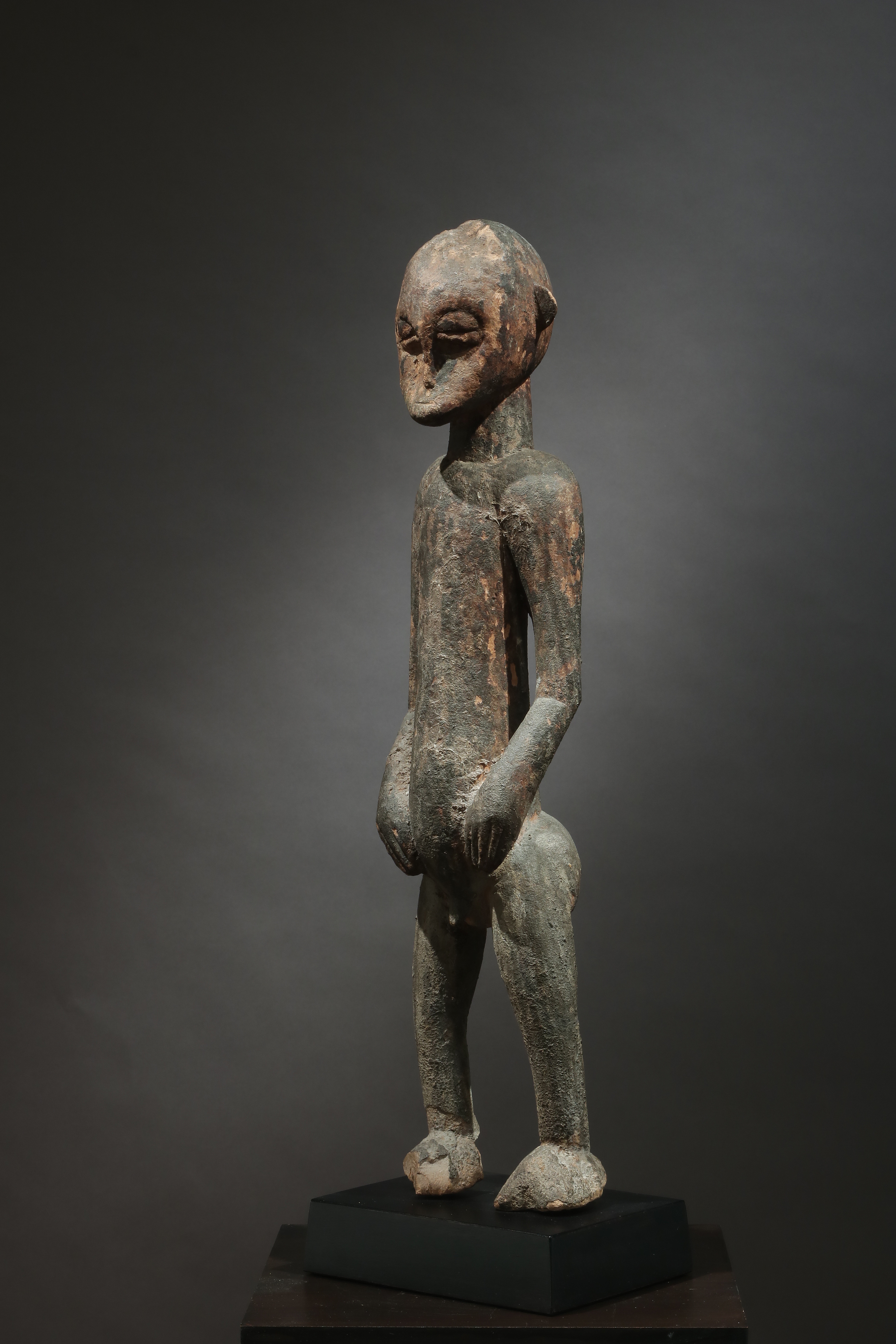 Standing male shrine figure