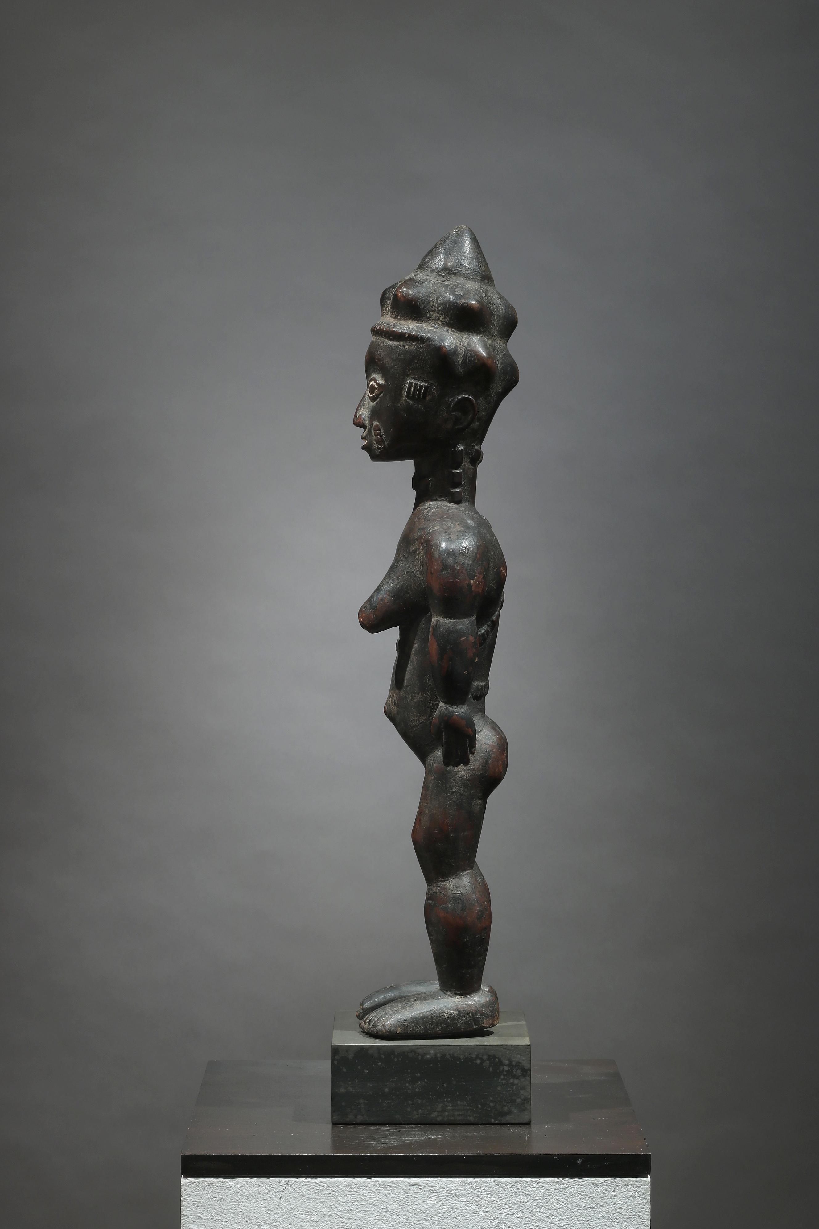 Standing female figure