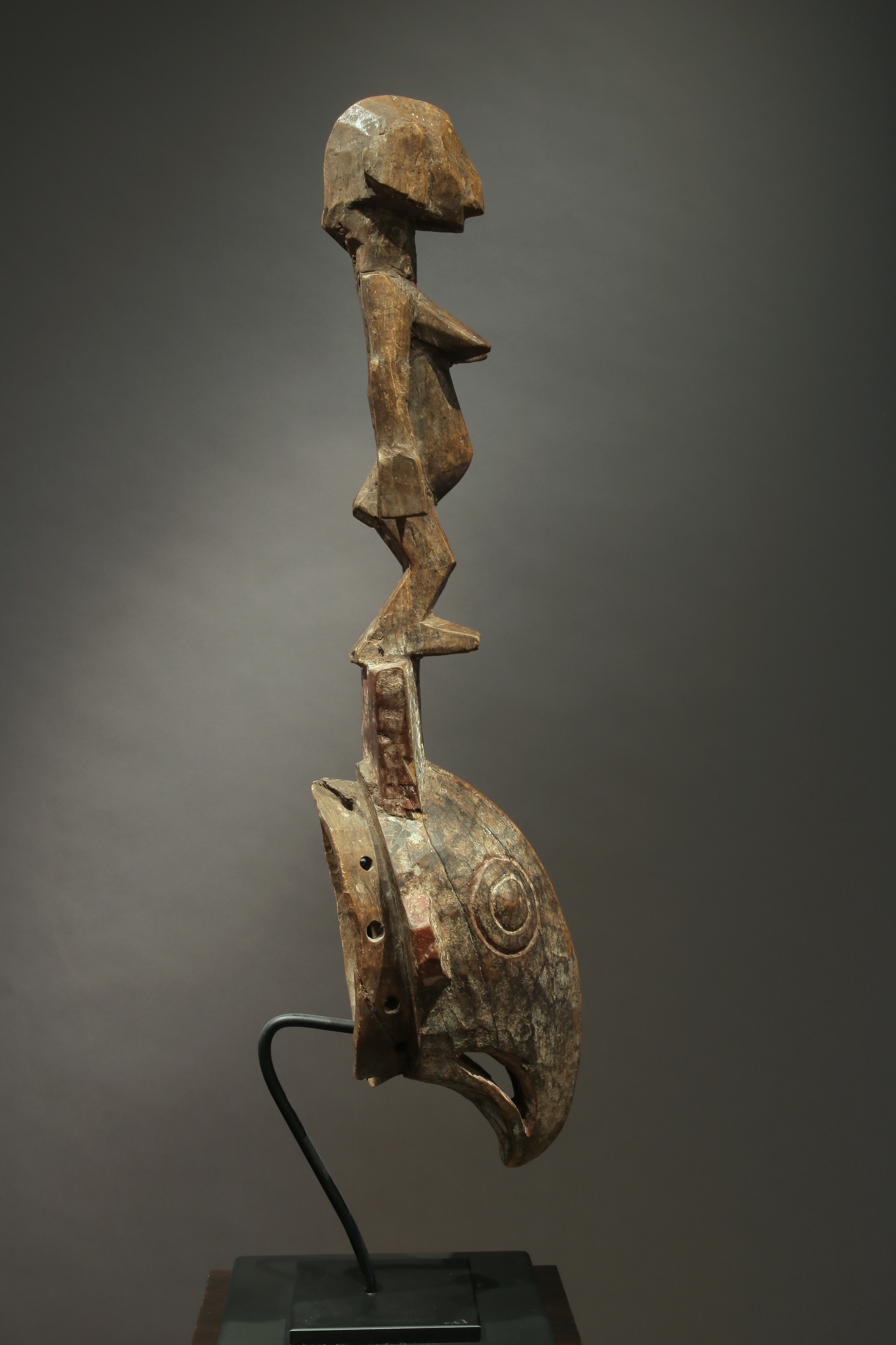Bird mask with figure on top