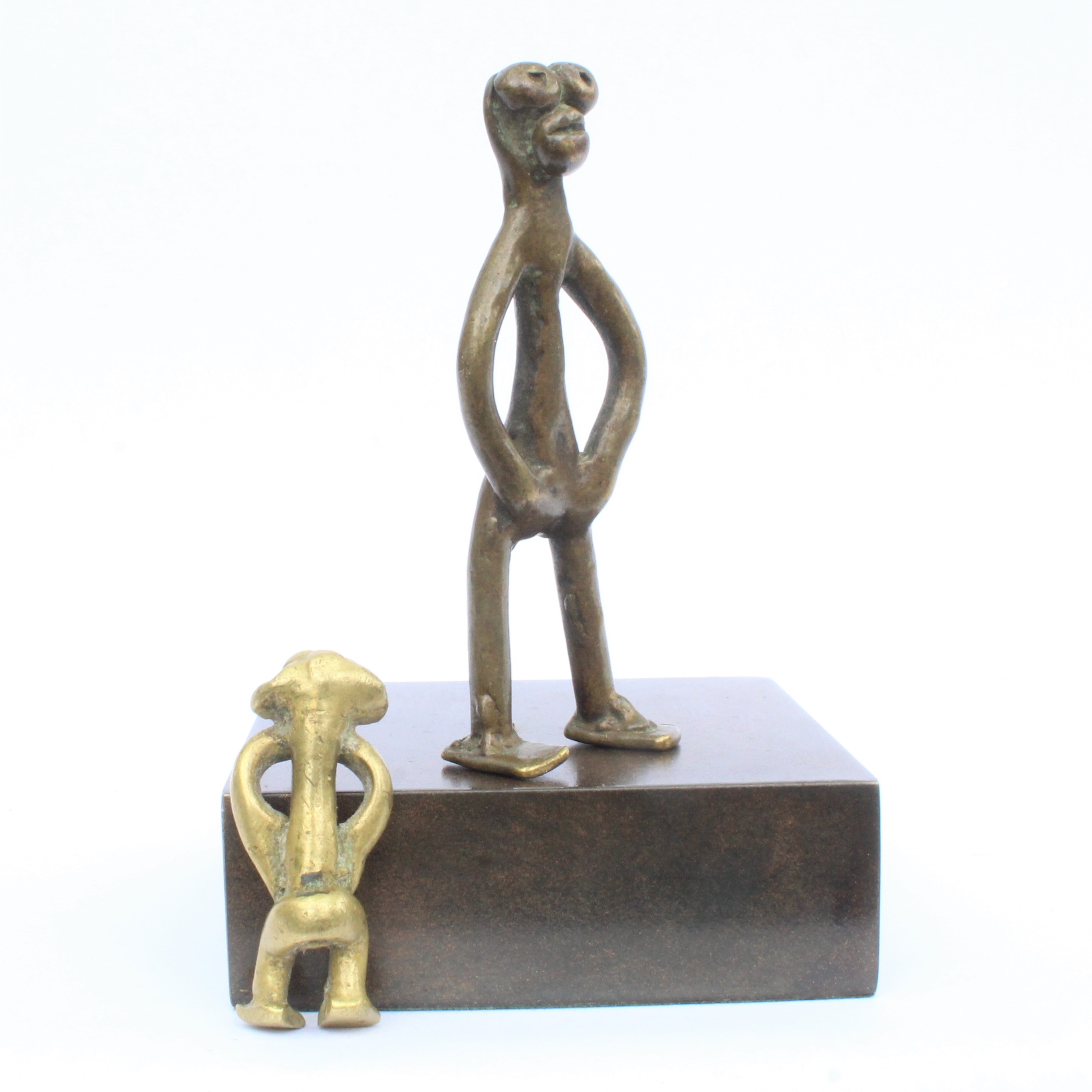 Two brass figures.