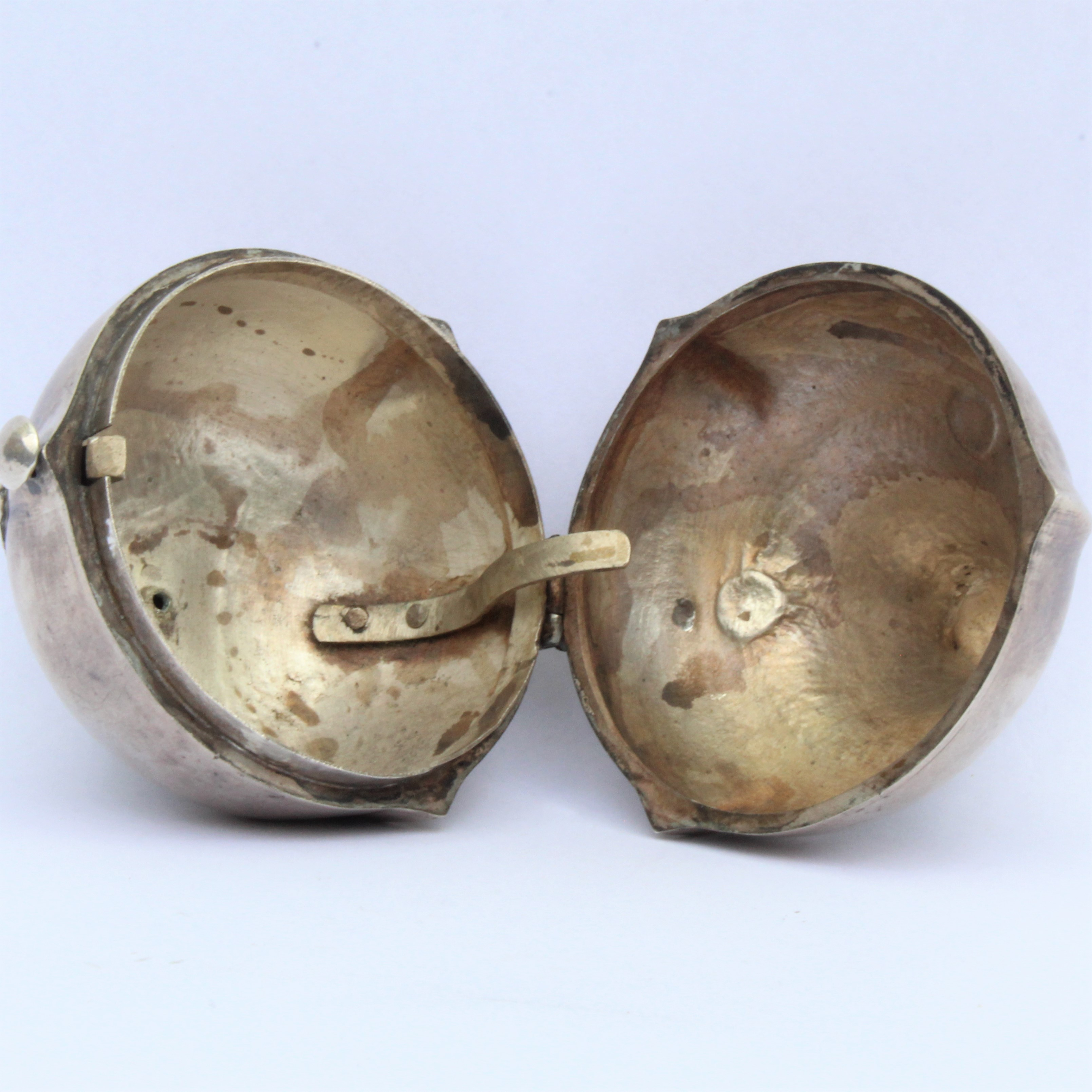 A silver betel nut or bezoar container.