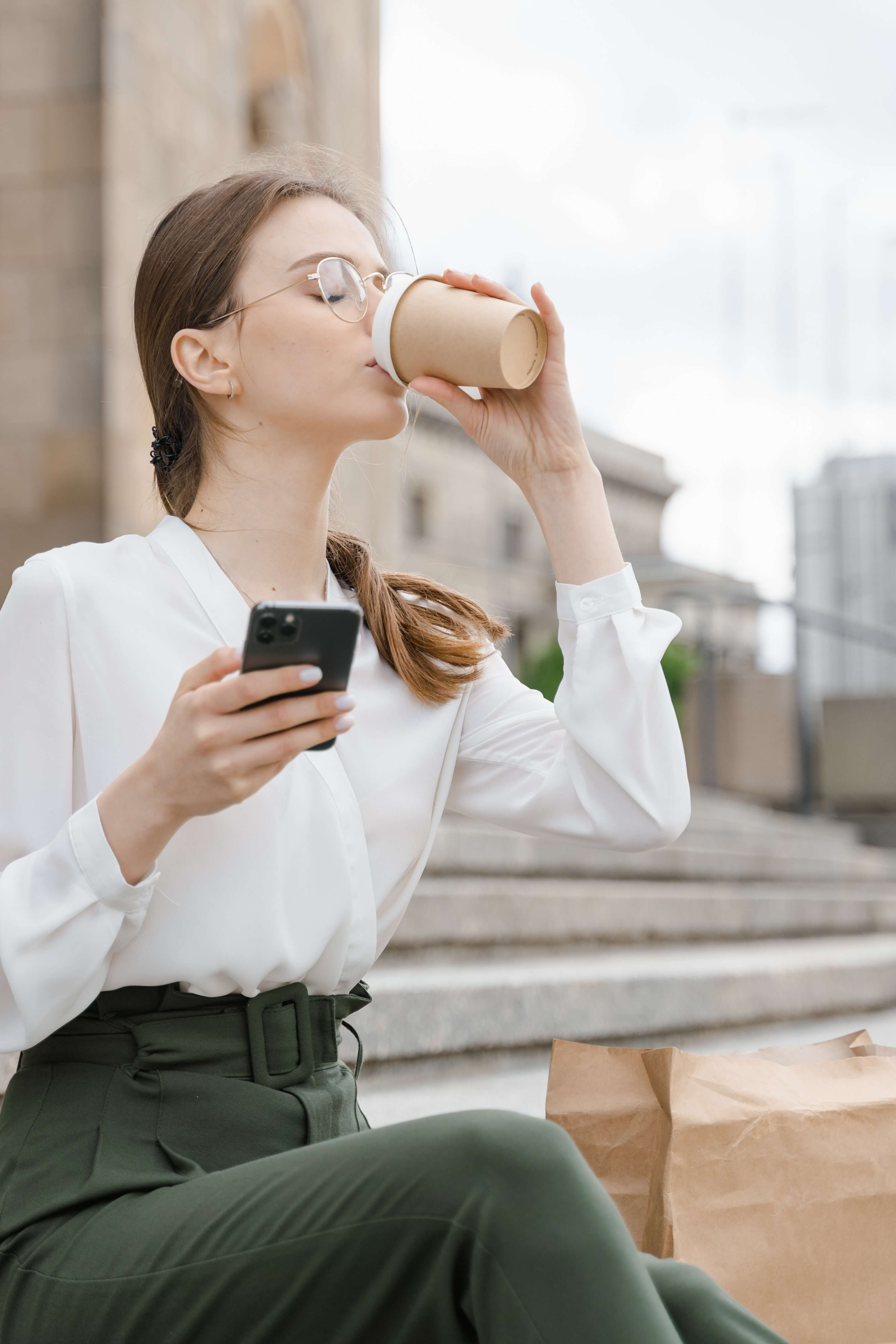 Woman working and drinking from cup
