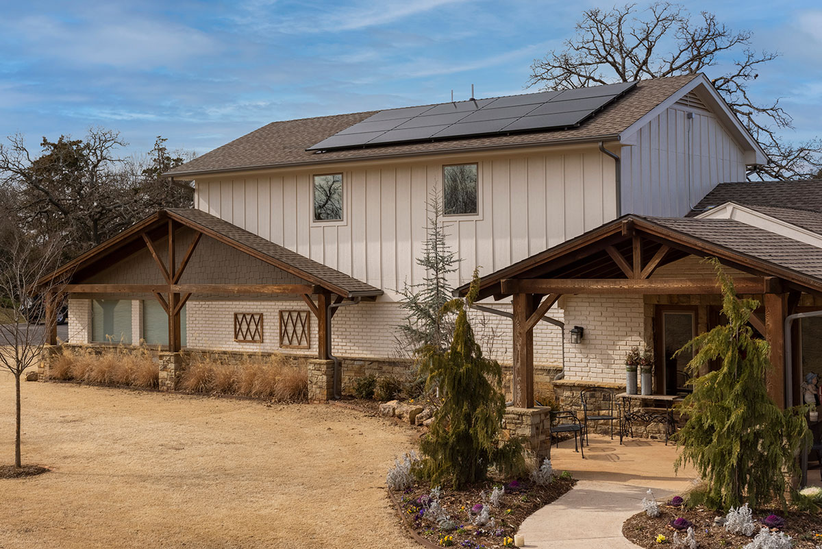 front of Edmond home with solar panels visible on roof