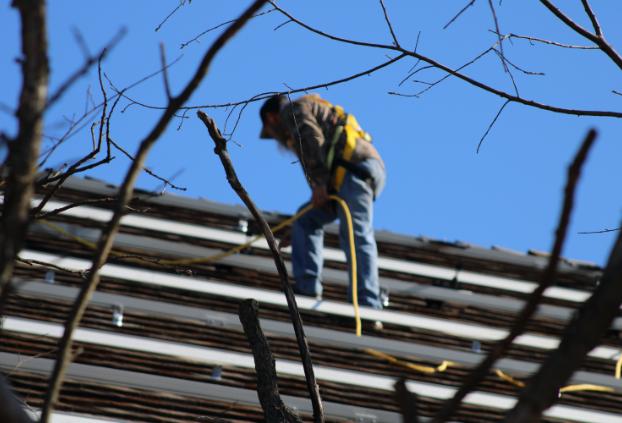 EightTwenty worker putting solar on roof