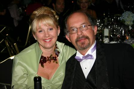 Jerry and his wife enjoy a nice bottle of wine at an event together.