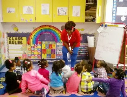 Arnita teaching Let's Move to a group of children as part of her volunteer service with Alabama Medical Reserve Corps (NAMRC).