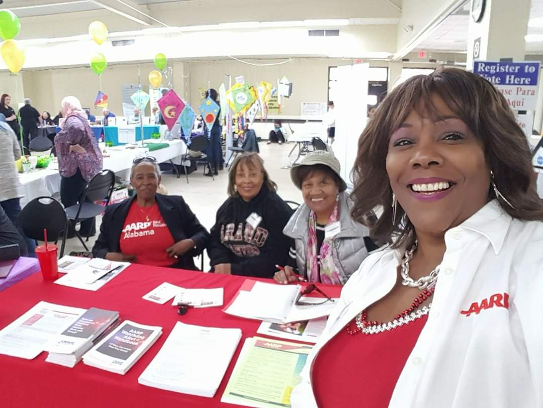Arnita helps to volunteer to man the booth with her local AARP chapter.