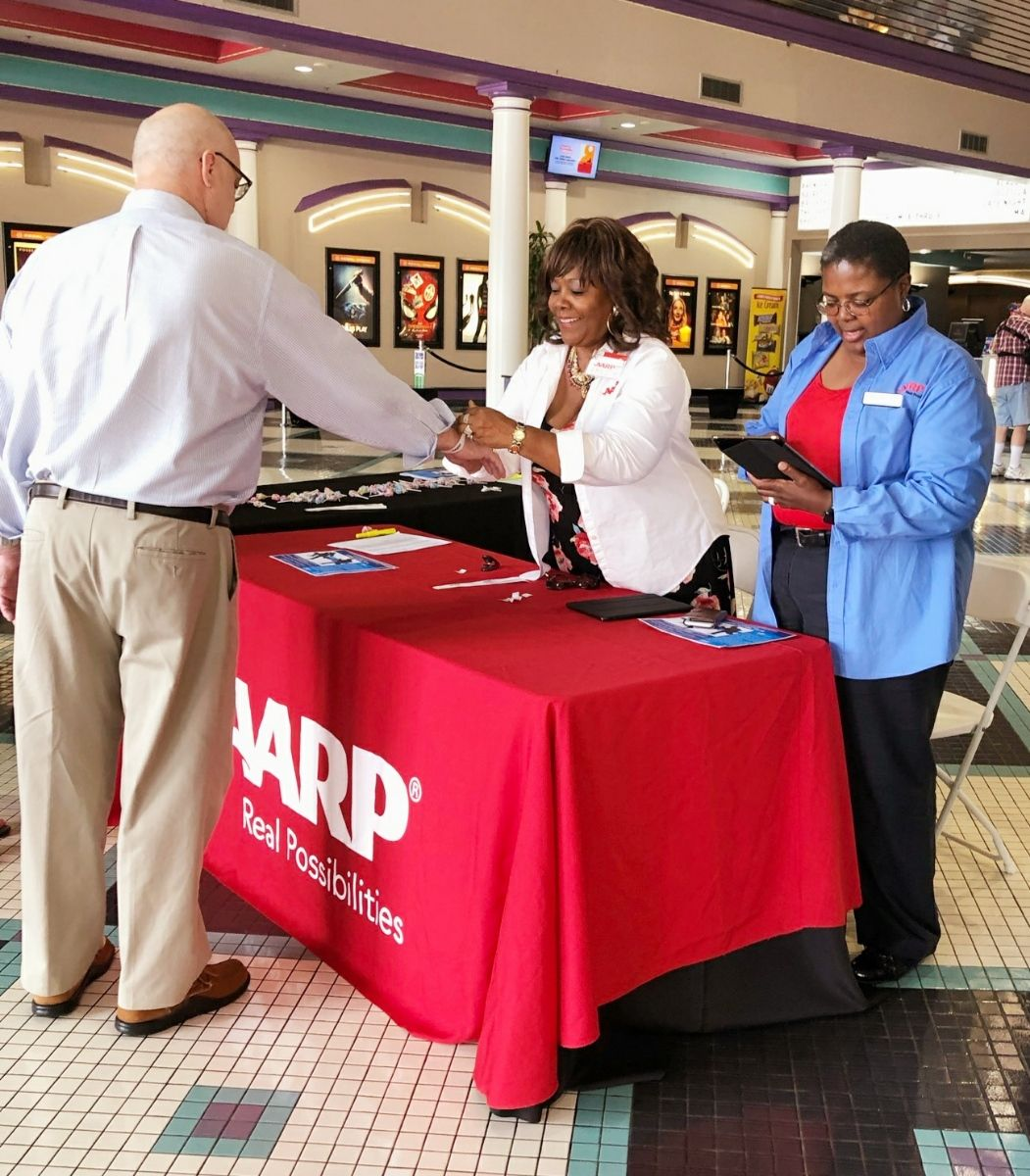 Arnita was able to combine her love of the movies with her volunteer work with AARP.