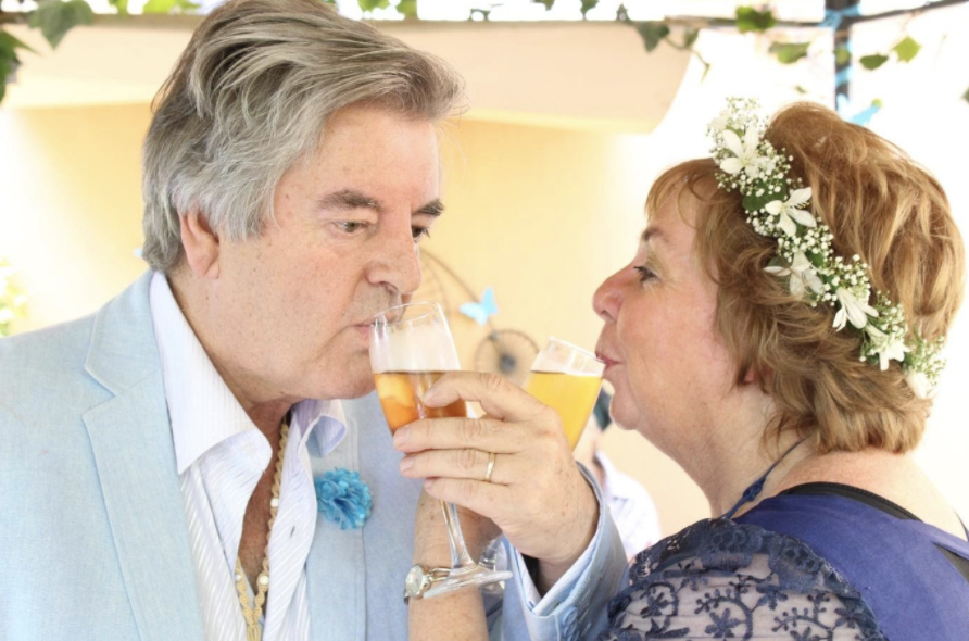 """Michael and Sue getting married in their garden cottage called """"Penny Farthing."""""""