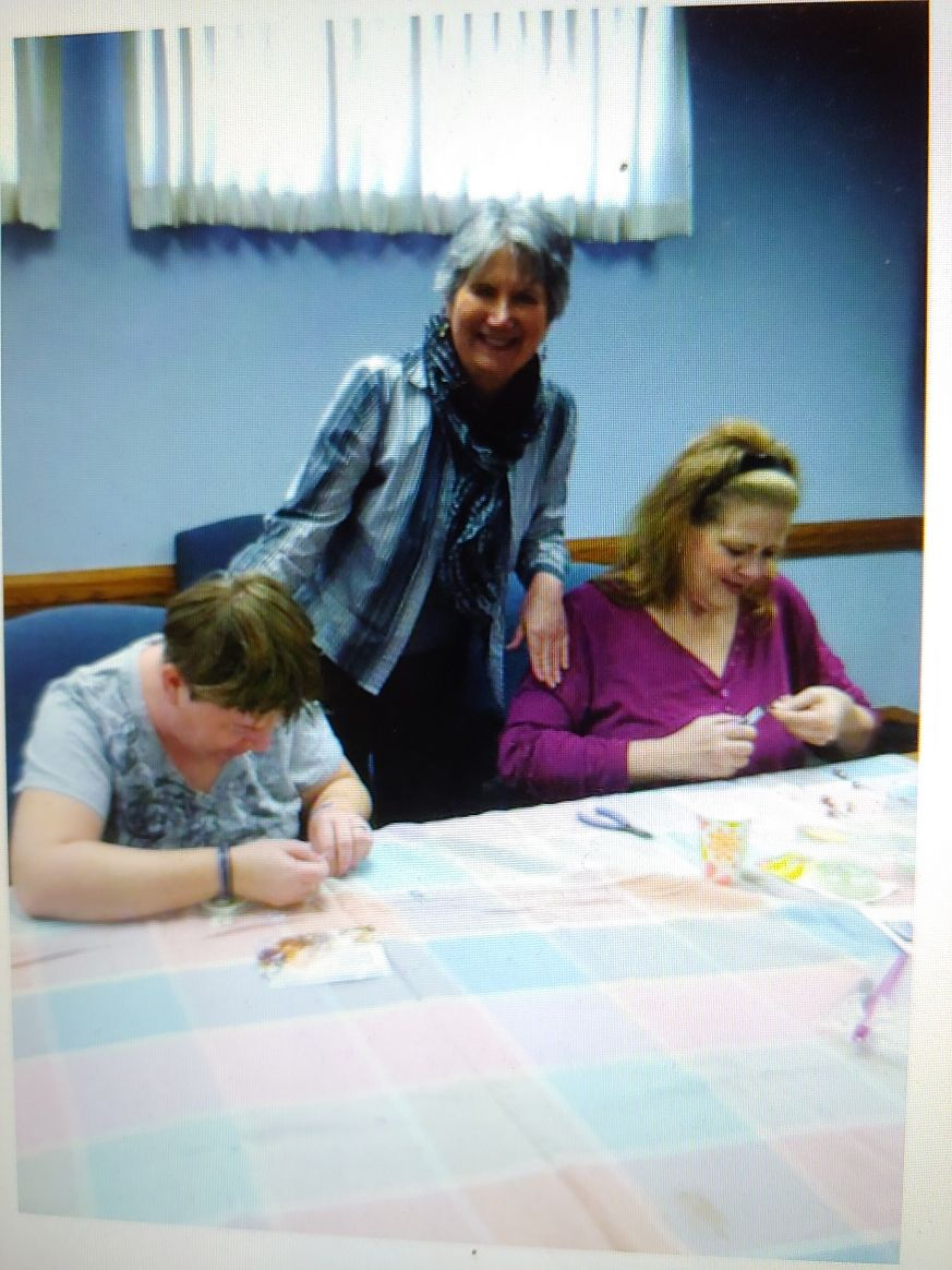 Linda enjoys a sewing class with some of her students before the pandemic.
