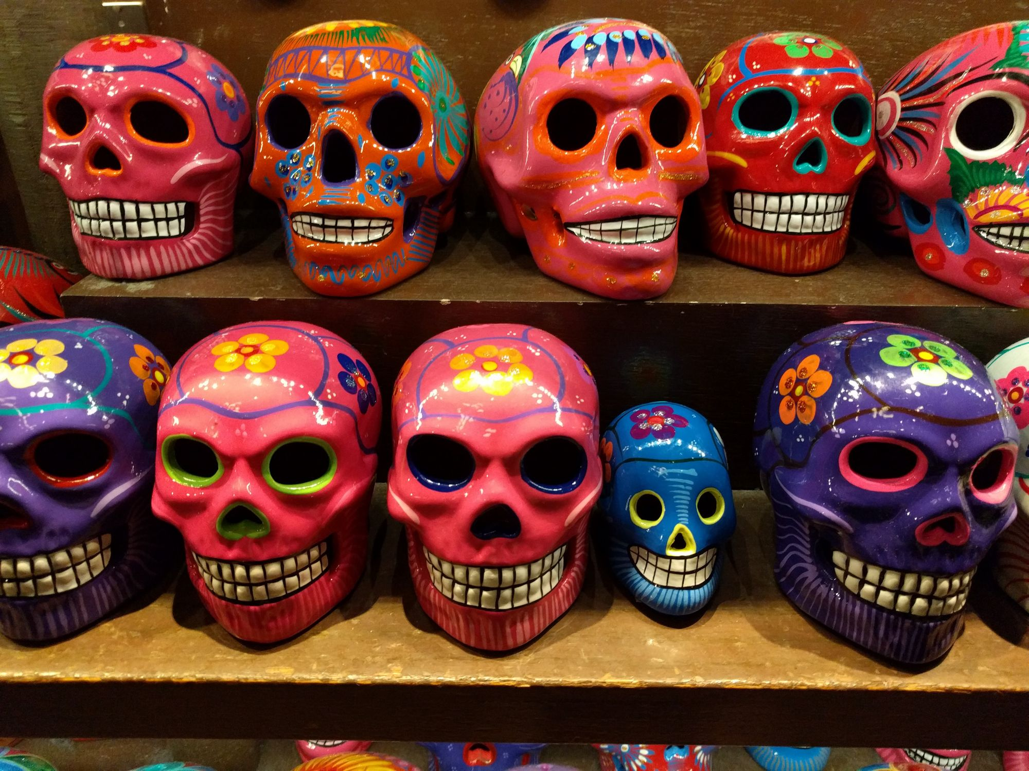 The bright colors of the skulls are a reminder of the celebratory nature of the festivities.