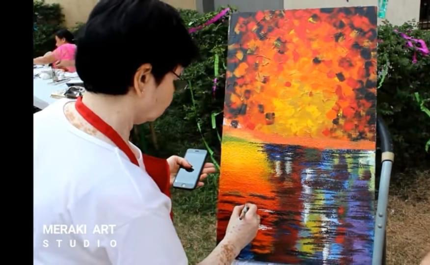 Binda taking time to enjoy painting one of her favorite past-times.