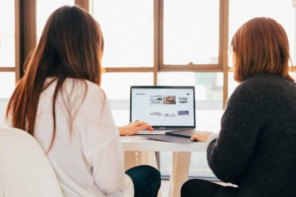 two women browsing for the best slack alternative
