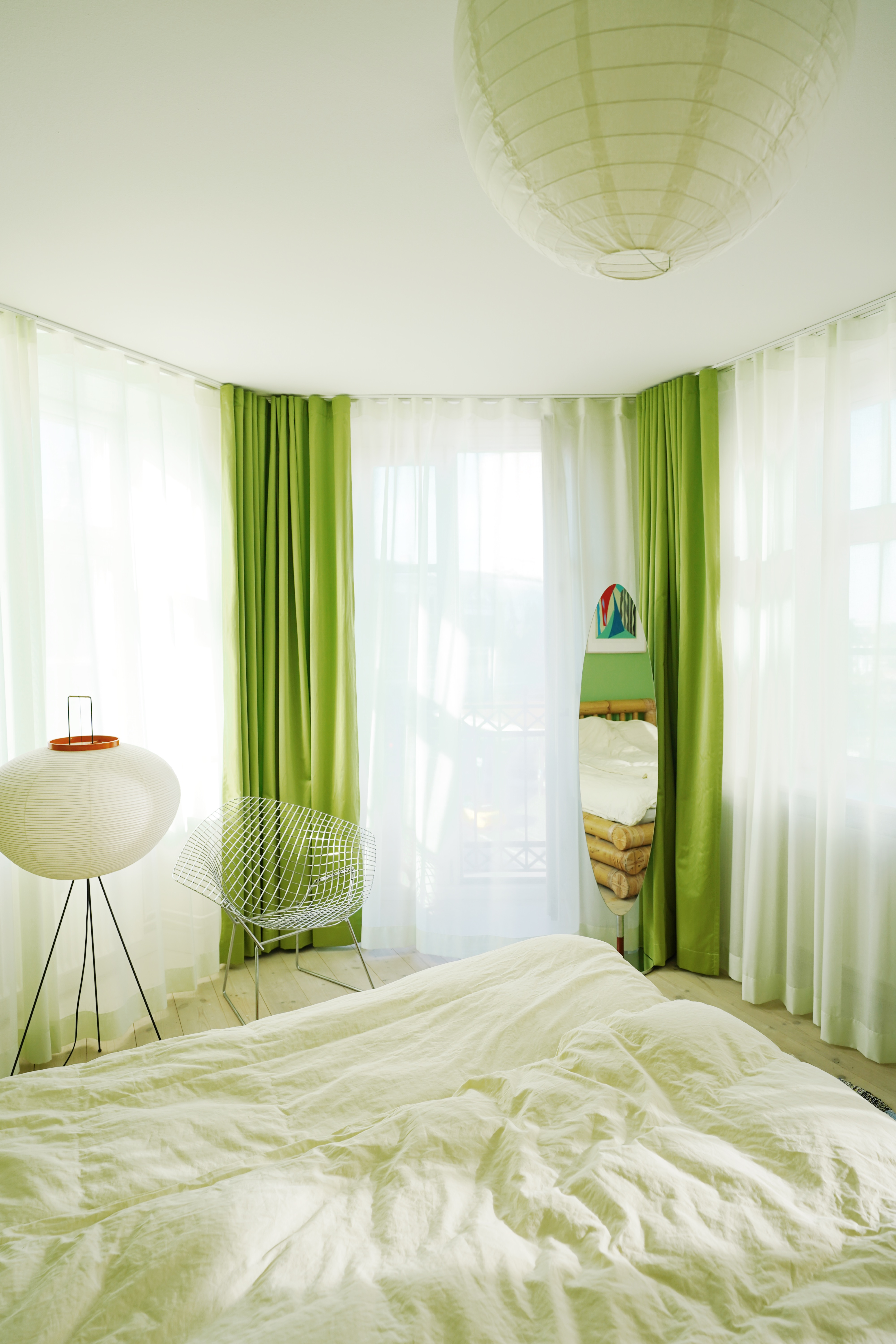 Green curtains from Arne Aksel shown in Marie Jedig's Apartment