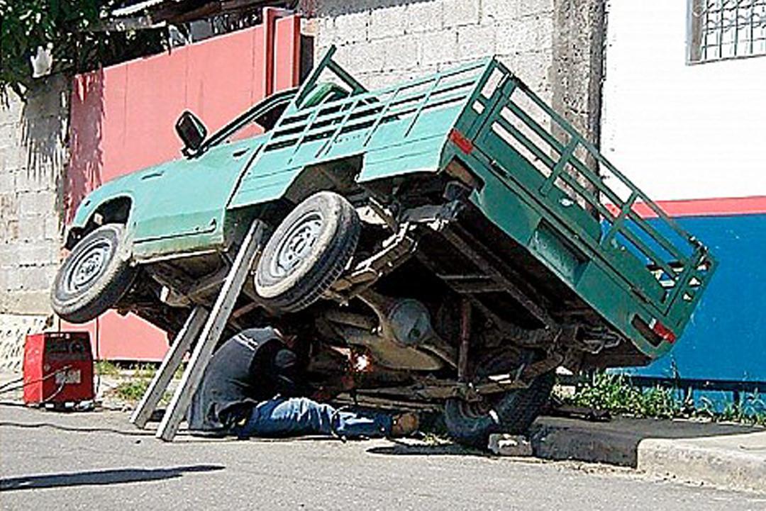 Man working under truck