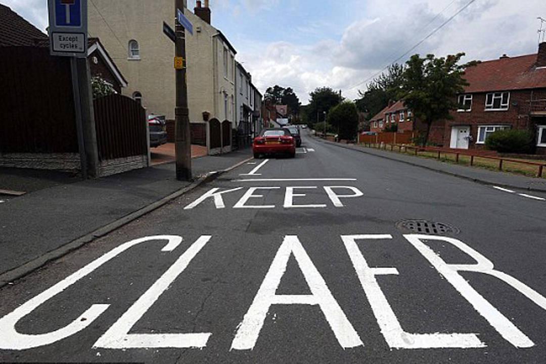Typo on road sign painted on asphalt
