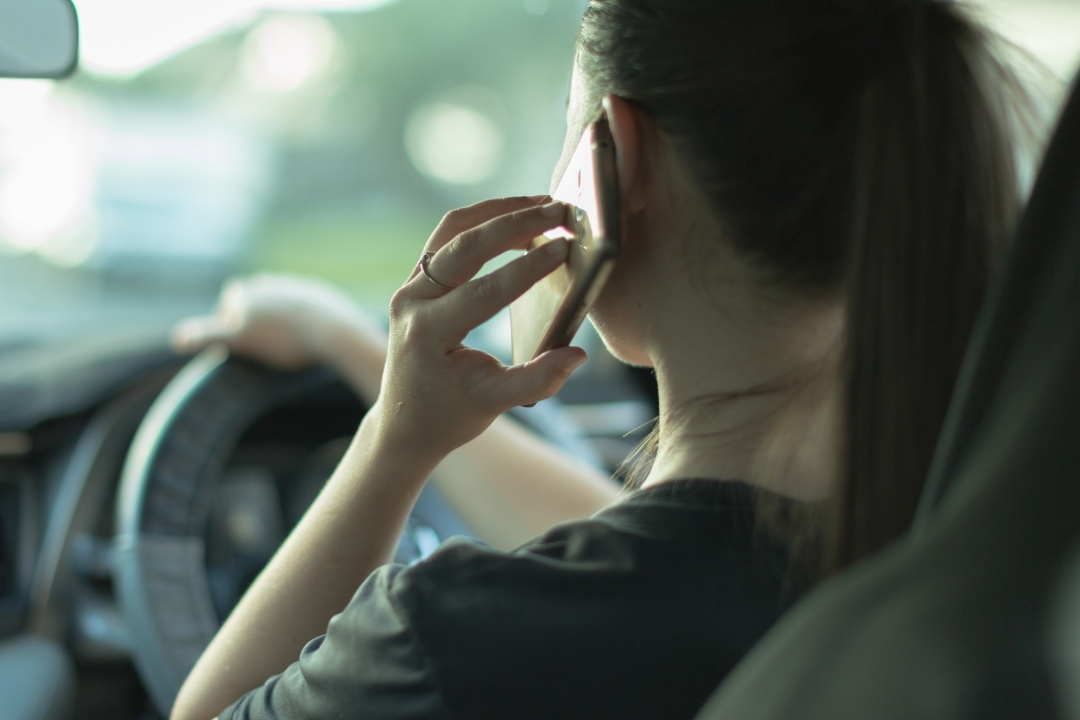 Women taking a phone call while driving