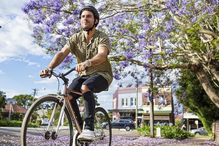 Man cycling in Brisbane streets