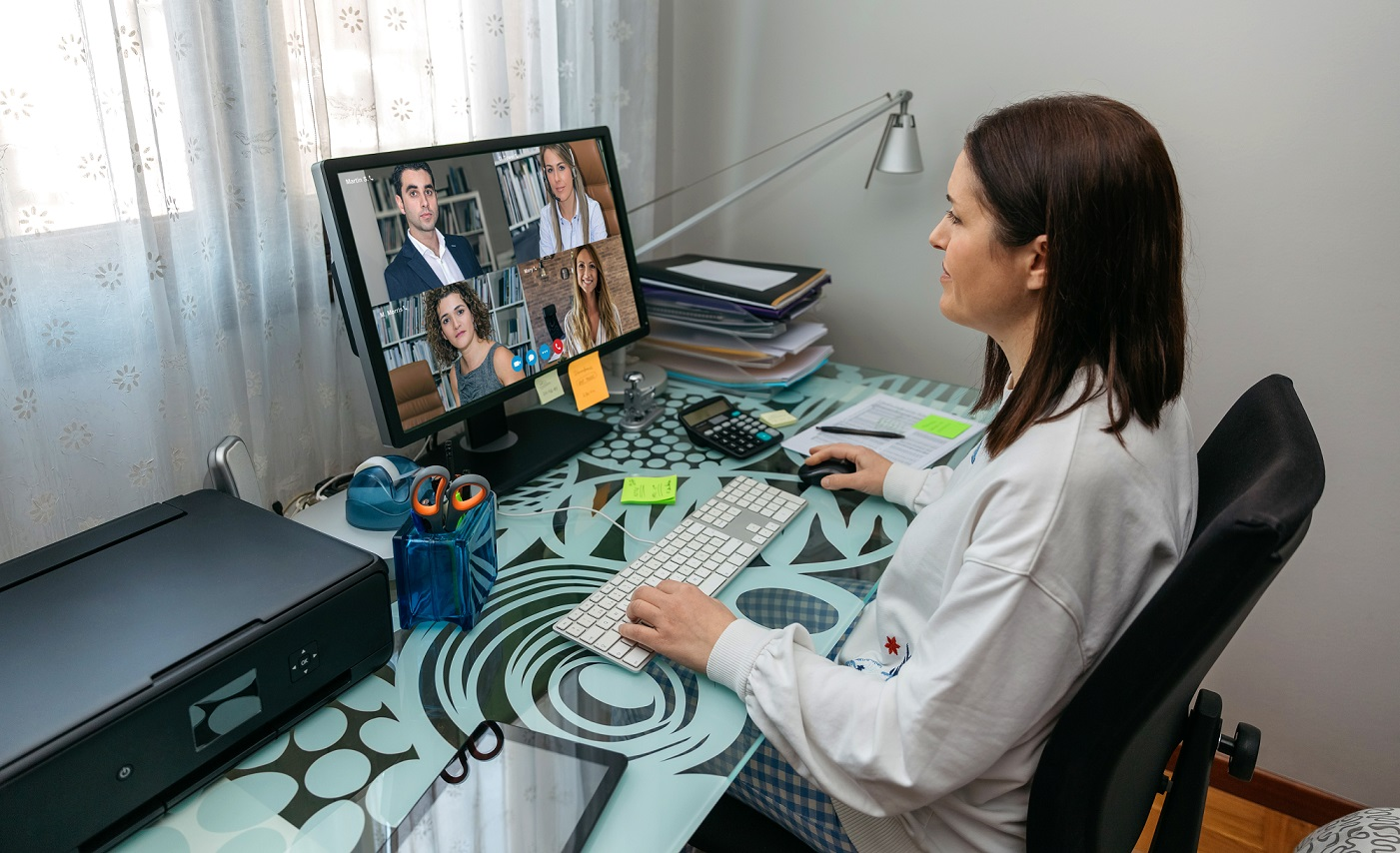 Woman working at computer from home