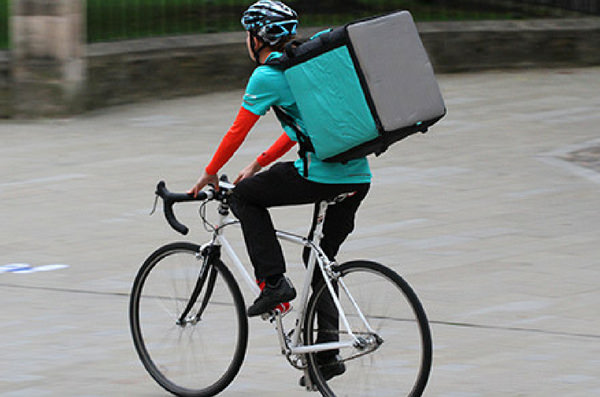 Delivery rider on bike