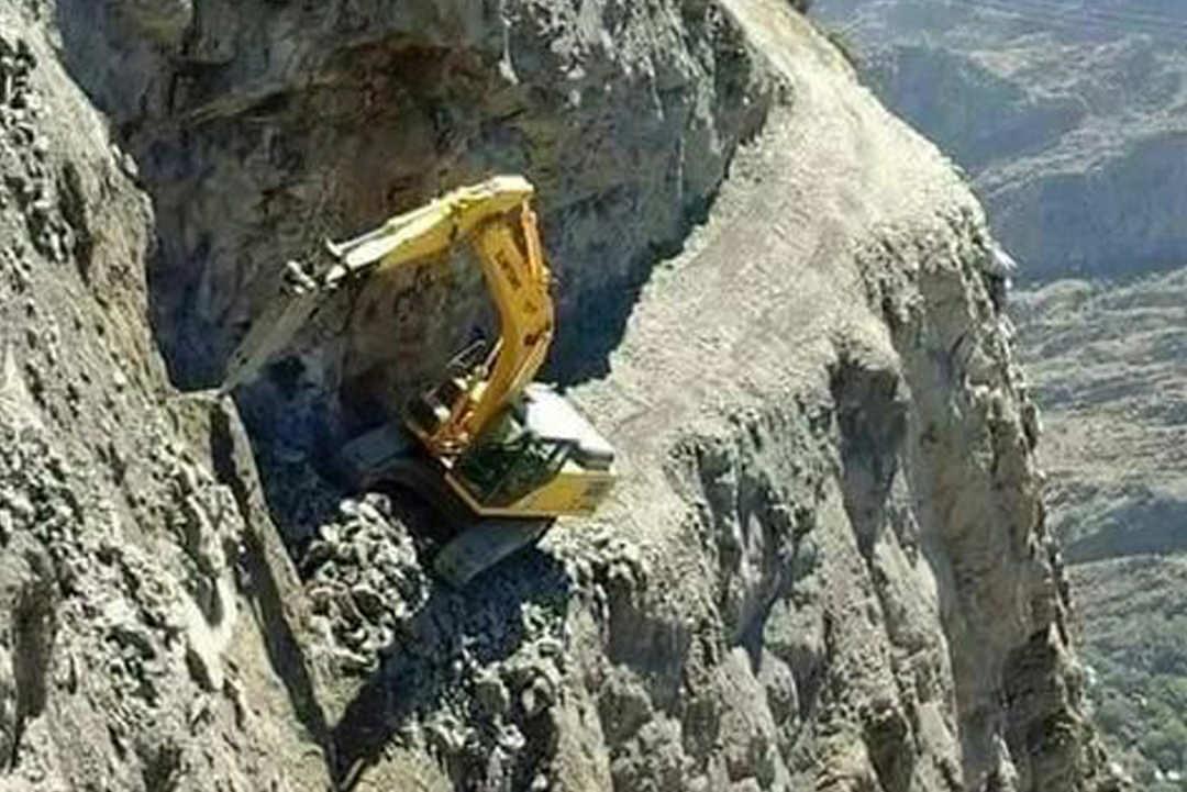 Bulldozer on cliff