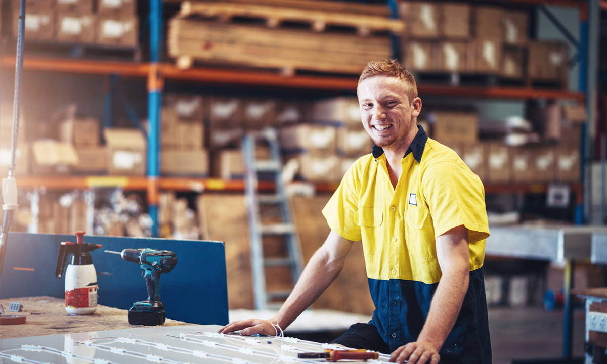 Young tradie in a warehouse