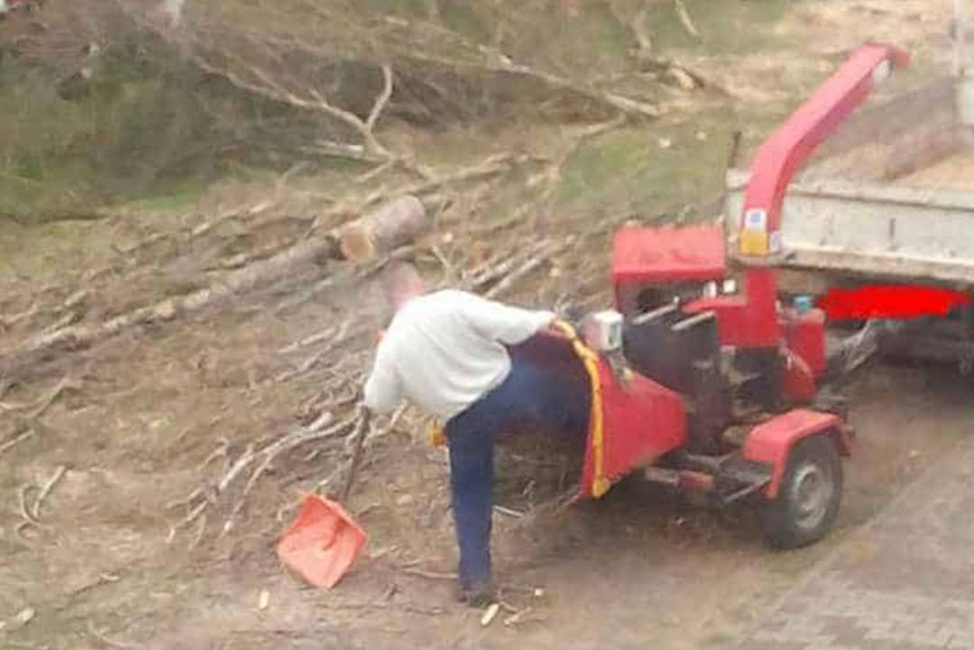 Man with leg in wood-chipper