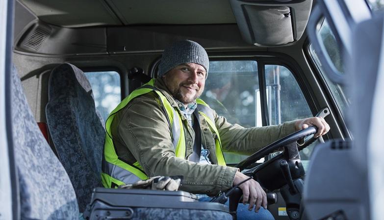 Worker driving a truck