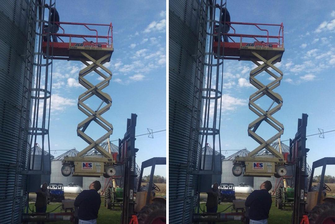 Man working dangerously on mobile elevated platform