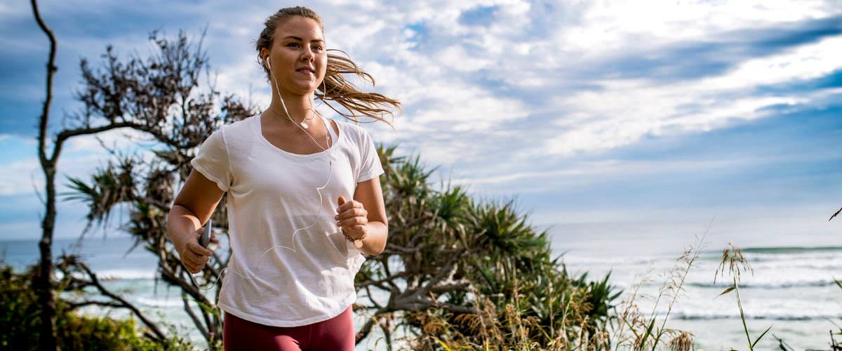 Self care, lady on a run near beach in Australia