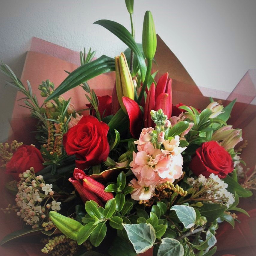 Lovely red and green bouquet.
