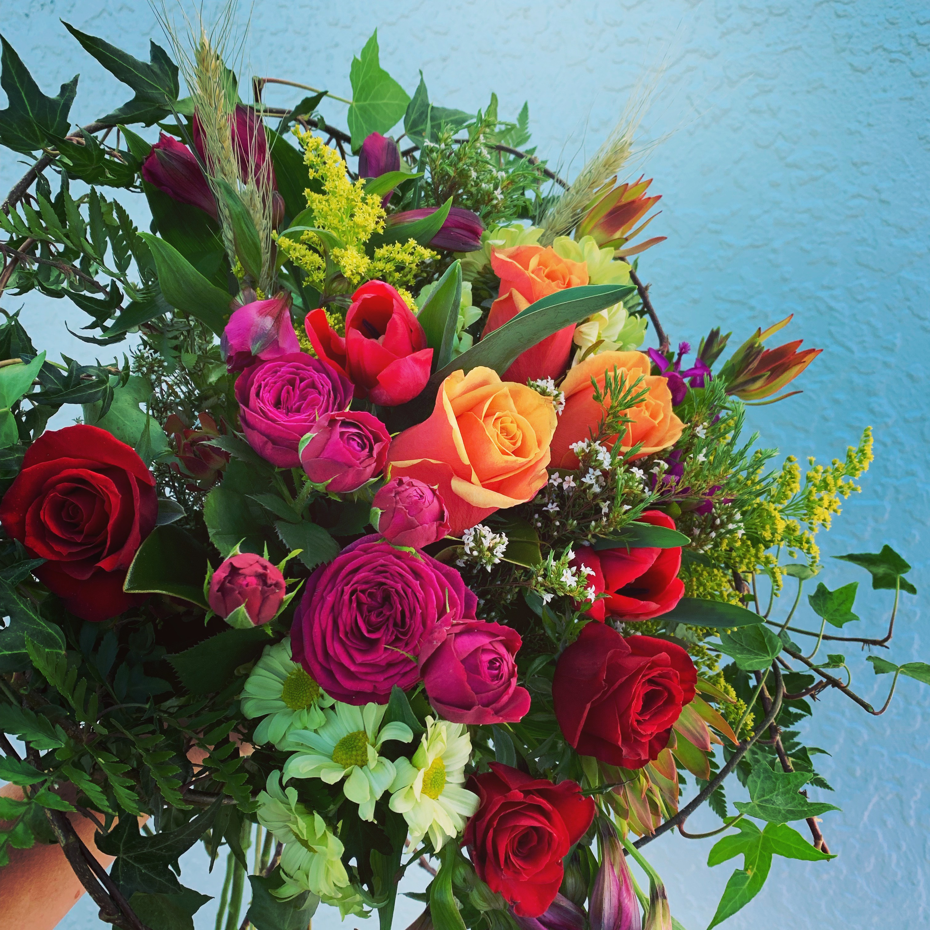 Mix of bright flowers. #The flower photo is an indication, flowers may change over the seasons. If there is a flower or colour you would like please let us know in the checkout notes. (no roses likes gerberas, likes red flowers ect).