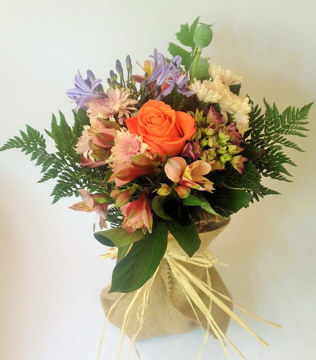 Lovely bouquet in a water jar.
