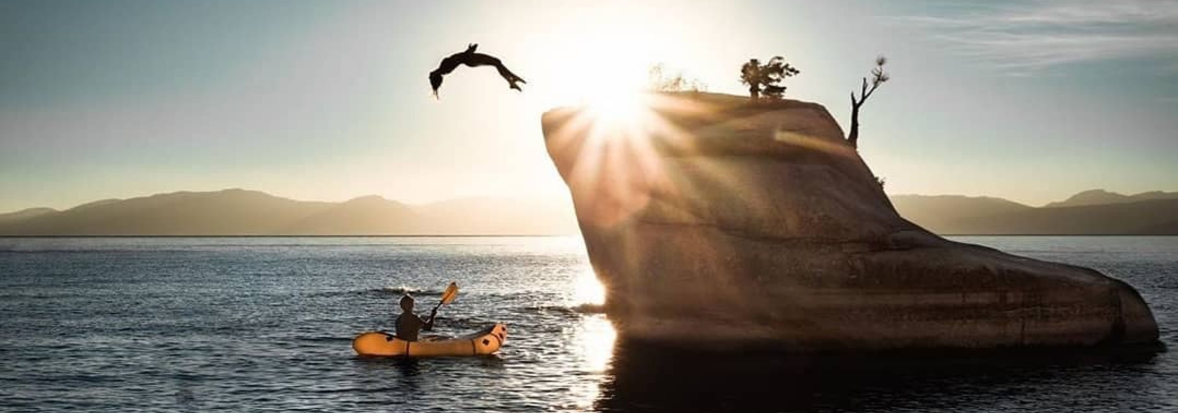 Instagram image showing a diver jumping off a small rock outcrop into the ocean.