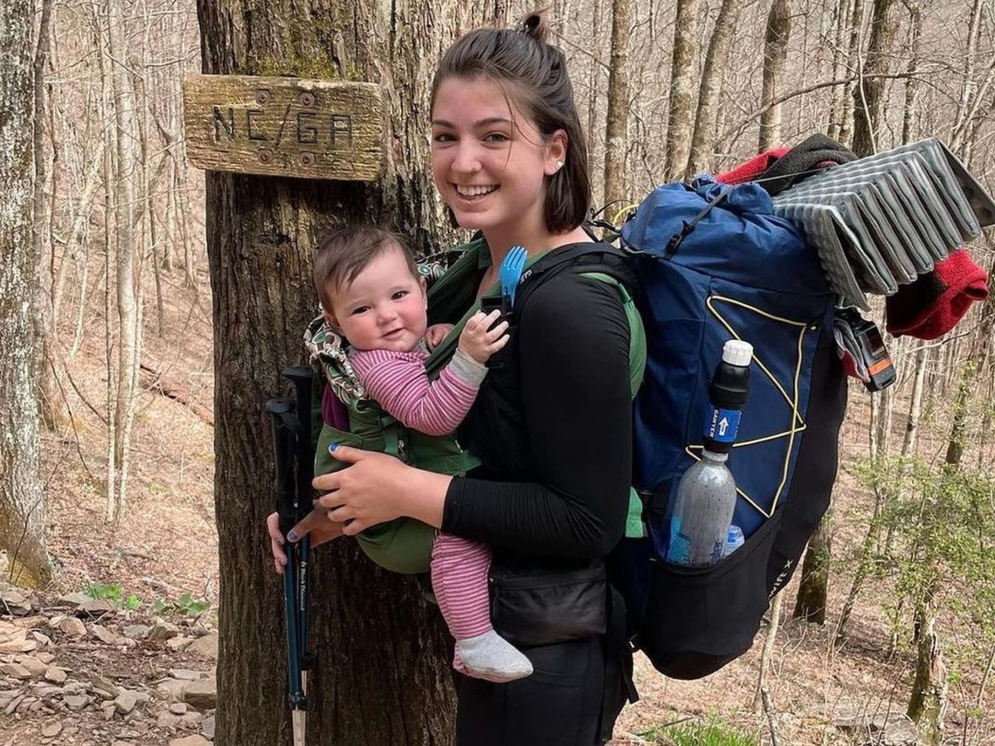 Instagram image showing a mom hiking with her baby strapped to her.