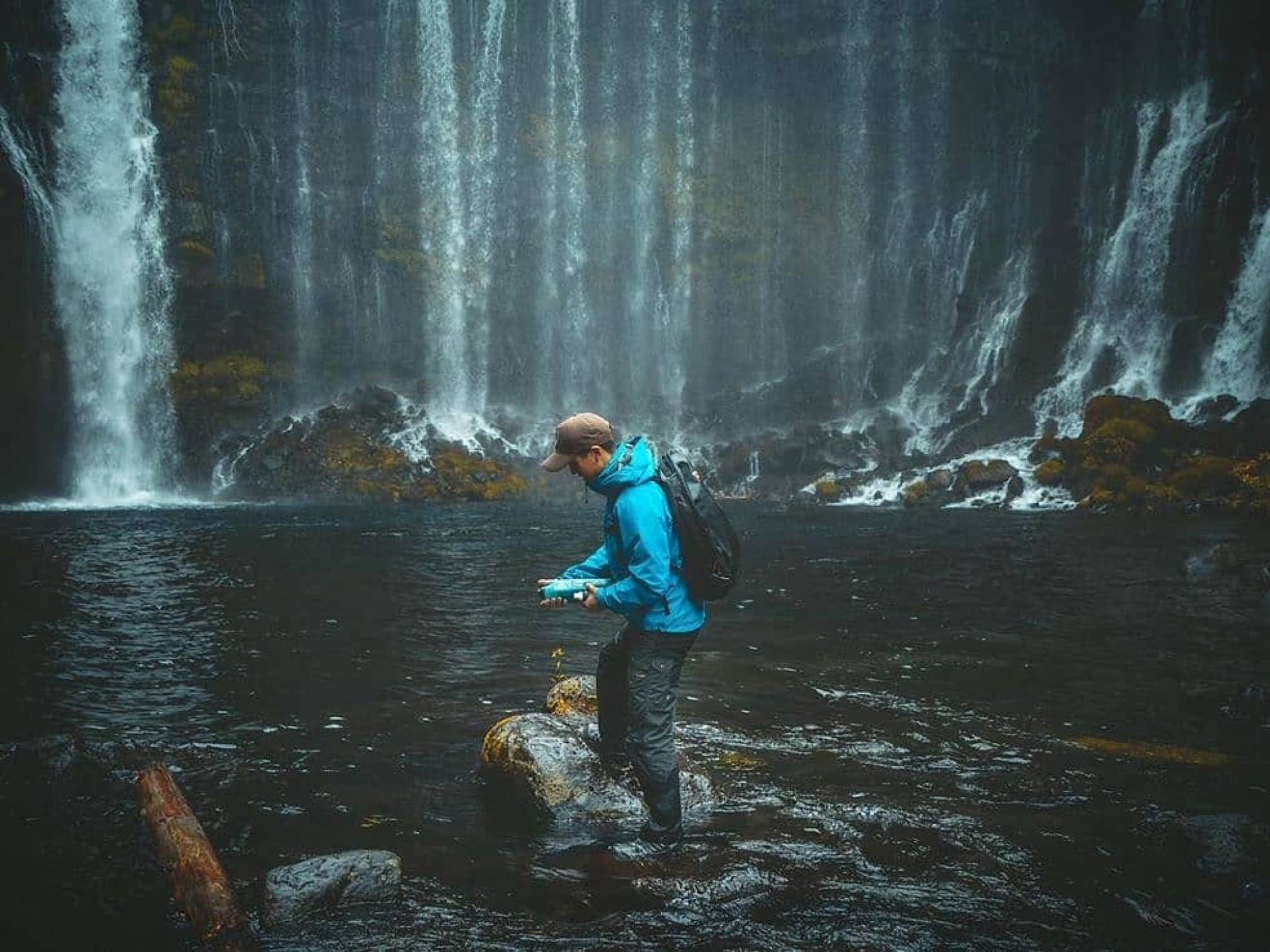 Instagram image showing a hiker posing in front of a waterfall.