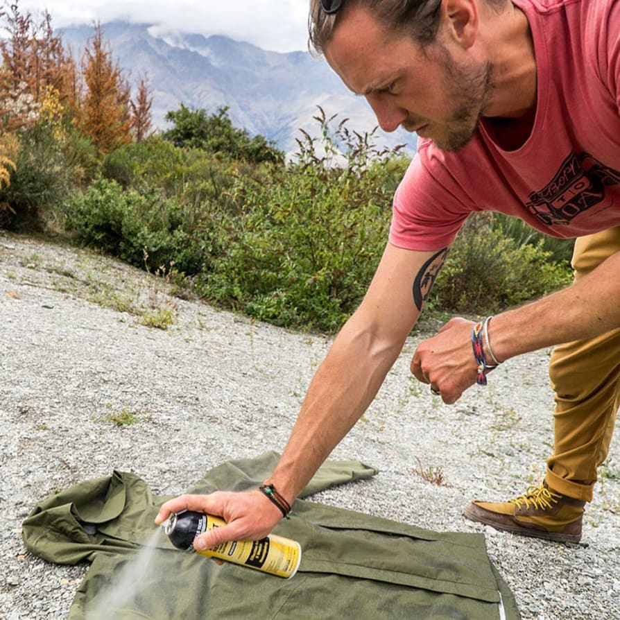 Instagram image showing Wilderness Culture spraying a jacket with insect repellent.