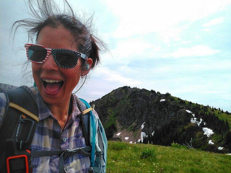 Happy_hiker_on_mountain_sunglasses