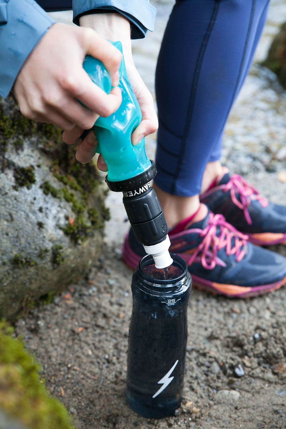 A Woman Uses her Sawyer Select S1 Water Filter to Fill her Water Bottle