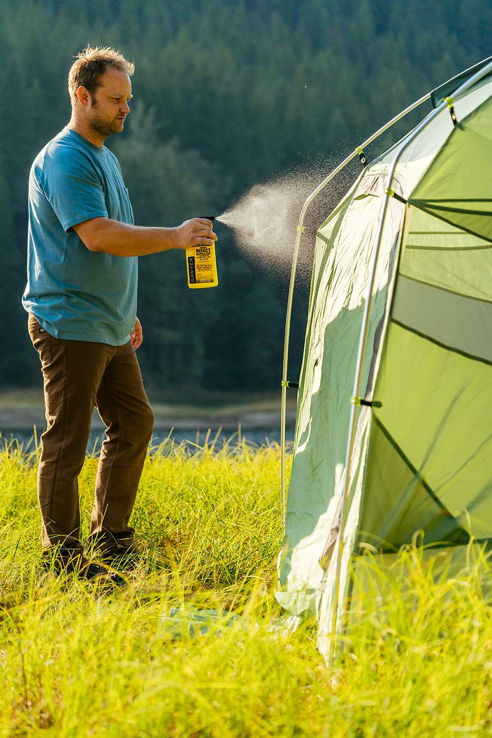 A Gentleman Treats his Tent with Sawyer Permethrin Fabric Insect Repellent for Clothing and Gear