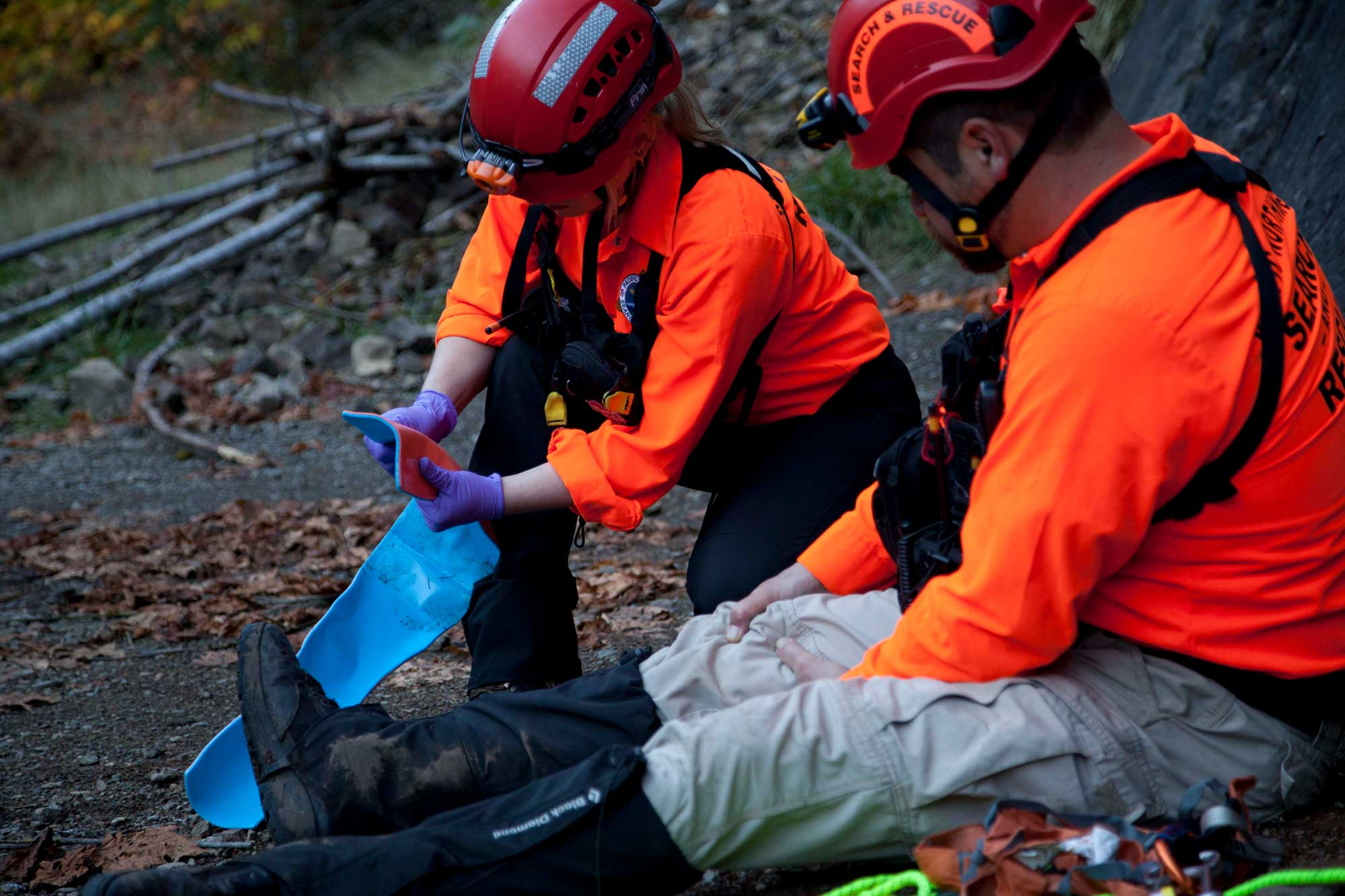 Search and Rescue Team Using a Sam Splint to Stabilize an Injured Leg