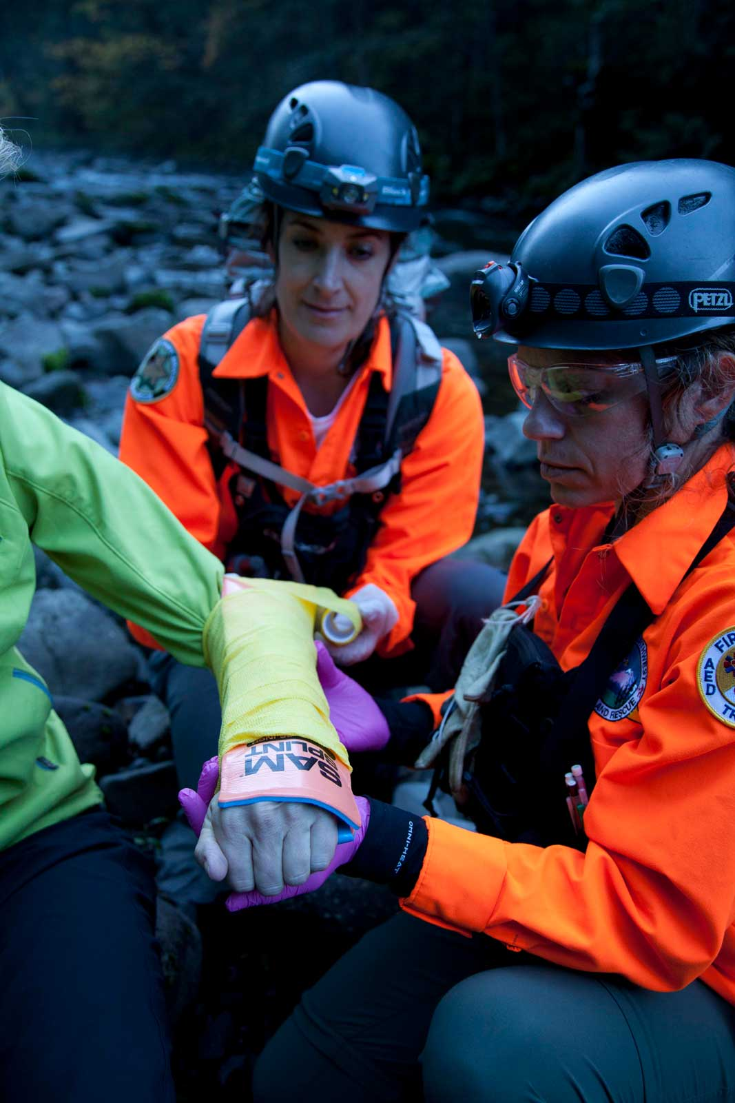 Two Search and Rescue Agents Use a Sam Splint on an Injured Person's arm